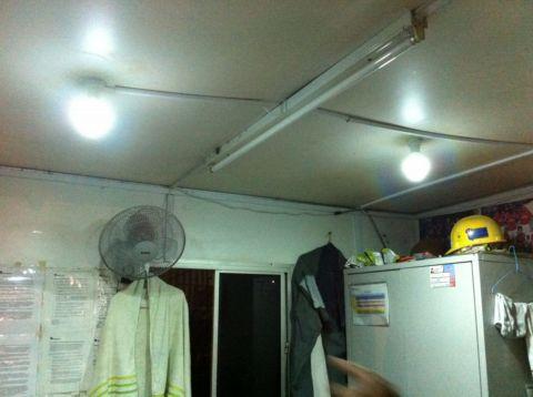Kamtexsolar solar power system powering LED lights at construction site in guardroom - Kamtexsolar Singapore